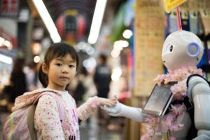 Asian child with friendly robot